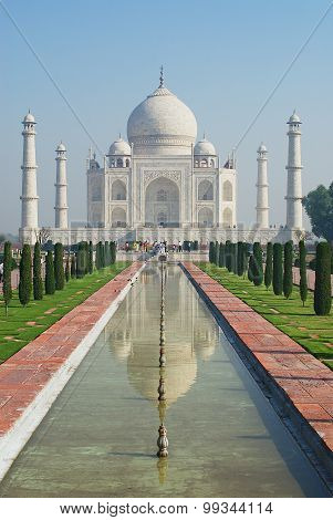 People explore Taj Mahal mausoleum at sunrise in Agra India.