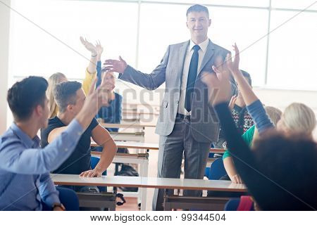 group of students with teacher on class learning lessons