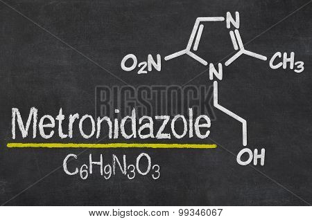 Blackboard With The Chemical Formula Of Metronidazole