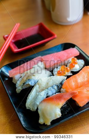 Set Of Japanese Sushi On The Black Plate
