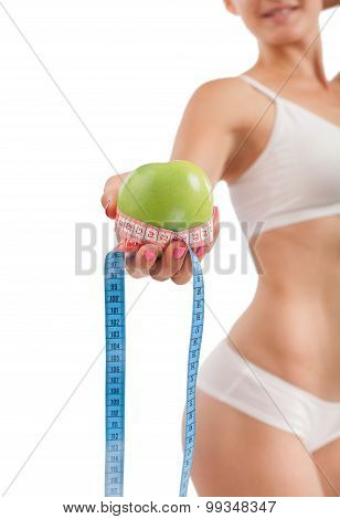 Sexy Girl With Green Apple And Measuring Tape.