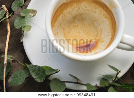 A cup of empty coffee on wood table