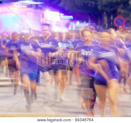 Large Group Of Runners In Blue Dresses, Motion Blur