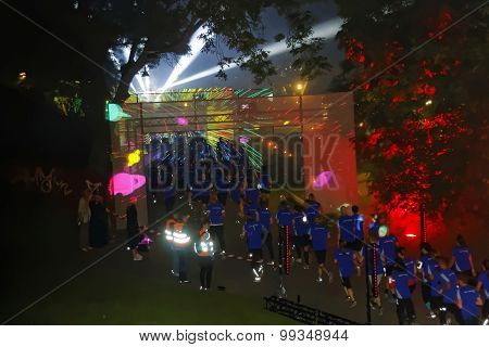 Group Of Runners In Blue Dresses, Laser Show