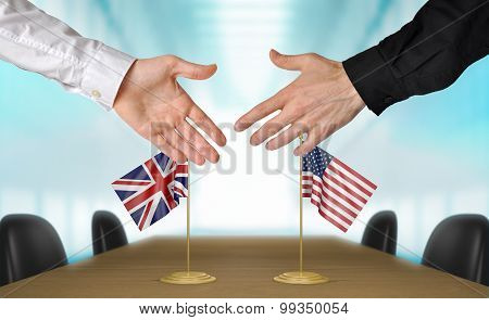United Kingdom and United States diplomats agreeing on a deal