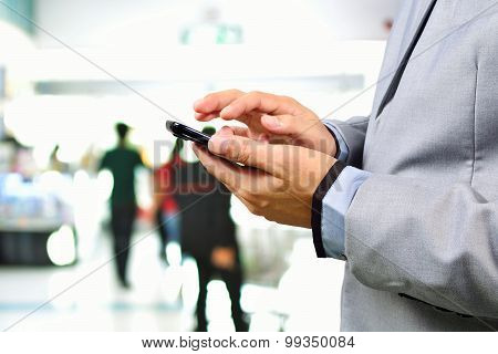 Business Man Using Cellphone Or Smartphone