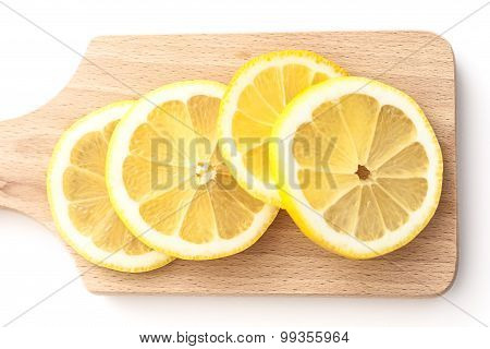Sliced Lemons On Cutting Board