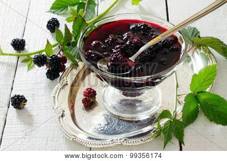 Blackberries, Canned In Juice On A Wooden Table