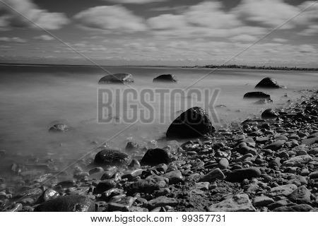 Rocks In The Sea. Black-and-white Photos On A Large Exposure.