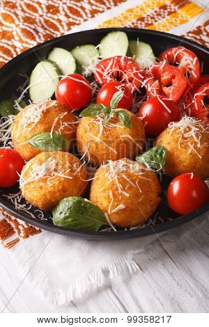Arancini Rice Balls With Parmesan And Fresh Vegetables. Vertical