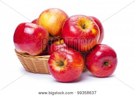 apples in a basket on white background