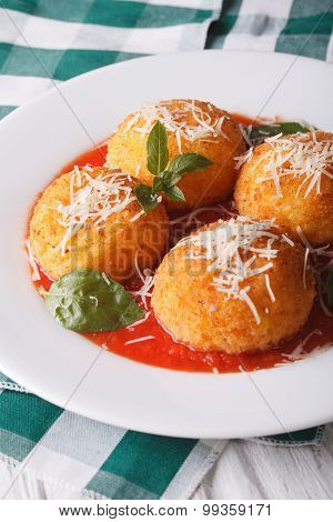 Delicious Rice Balls In Tomato Sauce On A Plate Close-up. Vertical