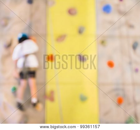 Blurred Image Of People Climbing Wall