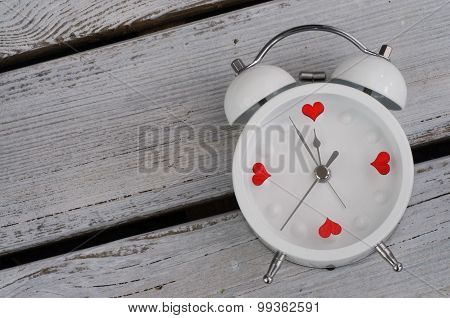Alarm Clock With Hearts Love Concept