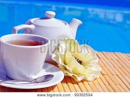 Cup Of Tea On A Saucer And Teapot