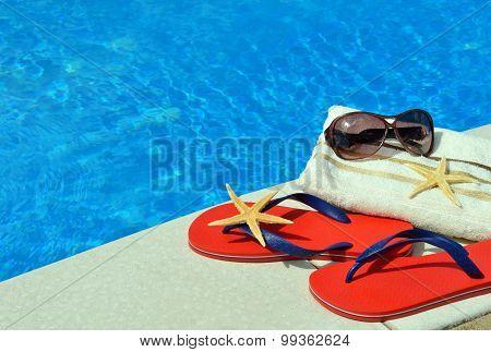 Pair Of Red Flip-flops, Sunglasses, Towel, Starfish