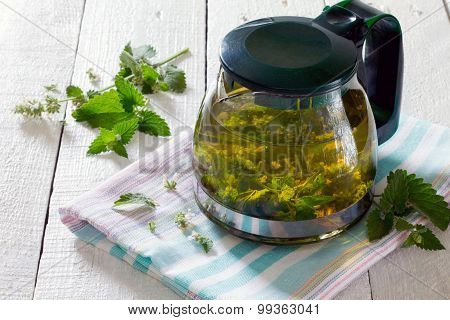 Teapot Of Herbal Tea With Fresh Mint Flower