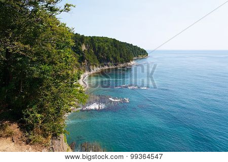 Amazing view from the high cliffs on beautiful coast with reefs