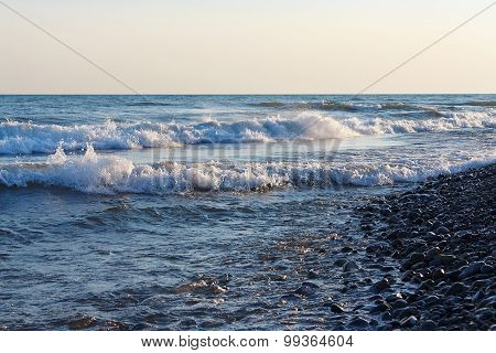Freestream waves on the beach in evening