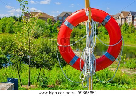 Lifebuoy on a background of luxury houses