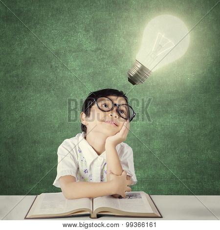 Adorable Little Student Looking At Light Bulb