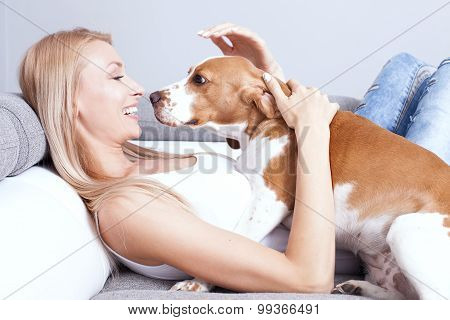 Happy Blonde Girl With Beagle.