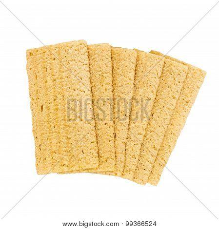 6 yellow wholegrain crispbreads - isolated