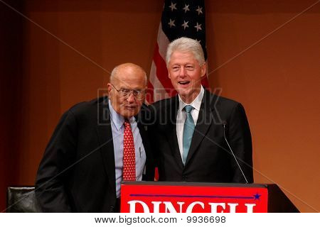 Former President Bill Clinton And Congressman John Dingell