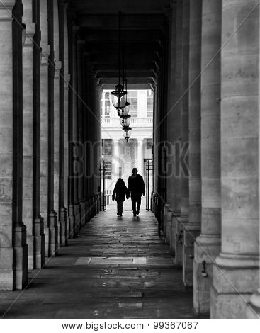 Dad and kid walking in a corridor in Paris.  Black and white picture.