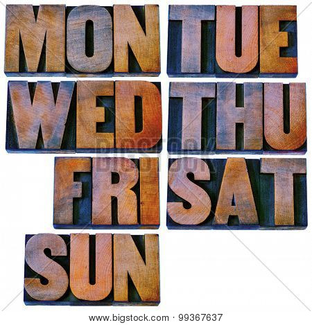7 days of week (first 3 letter symbols) in isolated vintage letterpress wood type printing blocks stained by color inks