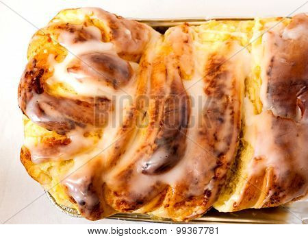 Freshly baked yeast cake with white sweet icing