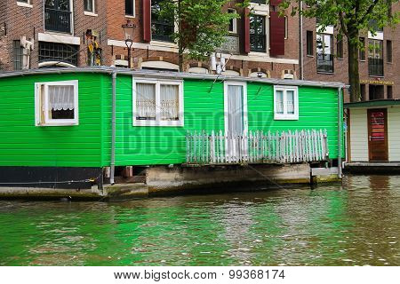 Houseboat On The Waterfront Canal In Amsterdam