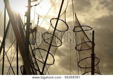 Fishing Nets Hanged On The Mast Of A Fishing Boat