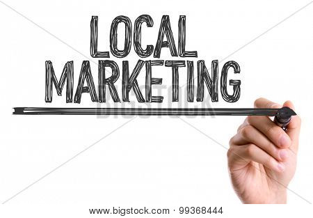 Hand with marker writing the word Local Marketing