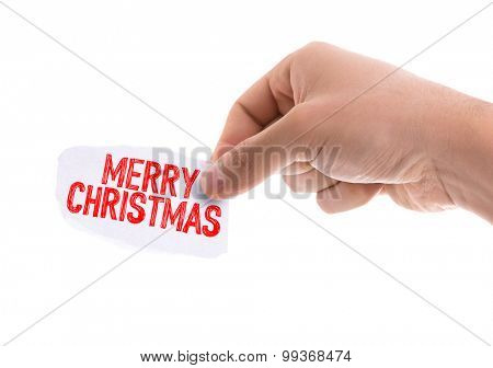 Piece of paper with the word Merry Christmas isolated on white background