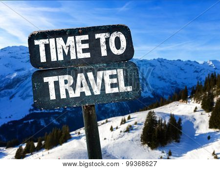 Time To Travel sign with alps on background