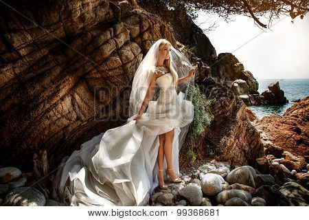 Sensual Woman In Wedding Dress Posing Outdoor.
