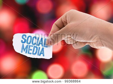 Piece of paper with the word Social Media with bokeh background