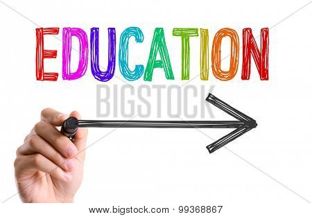 Hand with marker writing the word Education