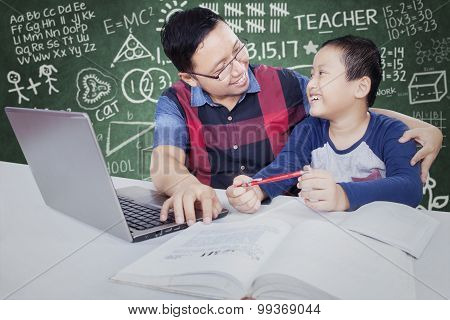 Male Student Talking With Teacher While Studying