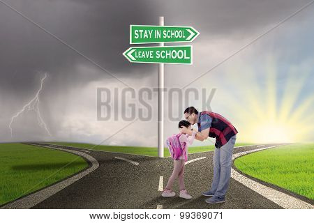 Man Kiss His Child On The Road