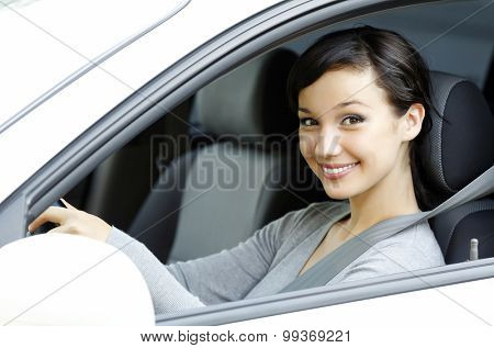 Cute asian female driver in white car smiling to you.