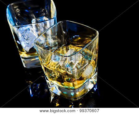 Top Of View Of Glass Of Whiskey On Black Table With Reflection