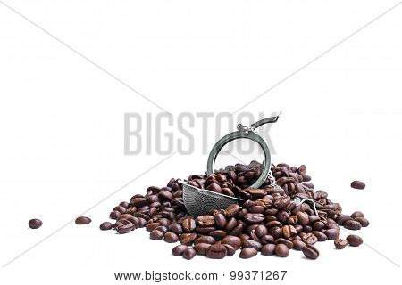 Fresh roasted coffee beans with strainer