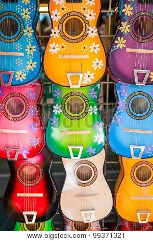 Background of colorful mexican guitars