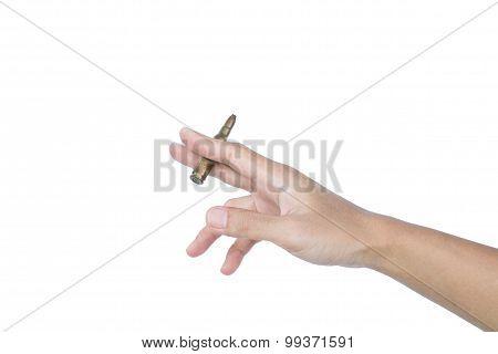 Hand taking machine gun bullet