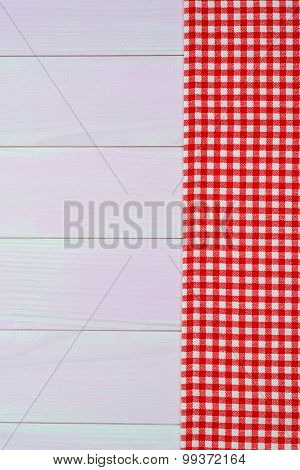 White And Red Towel Over Wooden Table