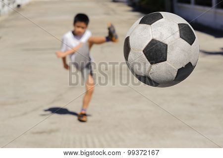 Boy Kick Football Fly To Near