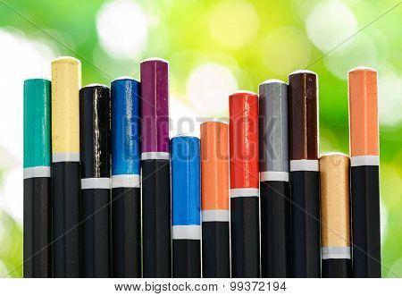 Bottom Of Color Pencil On Green Bokeh