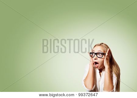 Portrait Of Surprised Young Handsome Blonde Business Woman Looking Shocked In Full Disbelief Hands O